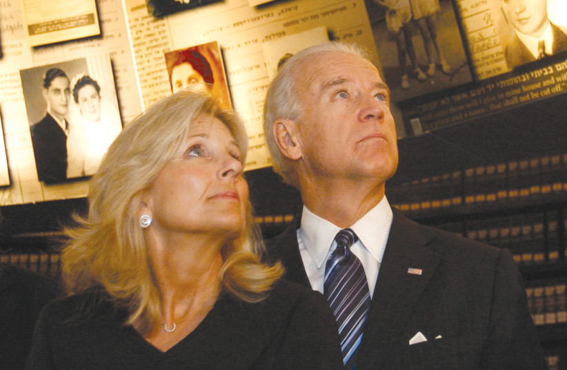 Then-vice president Joe Biden and his wife, Jill, visit the Hall of Names at Yad Vashem on March 9, 2010. Quoting the Irish poet, William Butler Yeats, Biden wrote in the visitors' book: 'Every day Israel makes a lie of the poet's words – too long a suffering makes a stone of the heart. (photo credit: RONEN ZVULUN / REUTERS)
