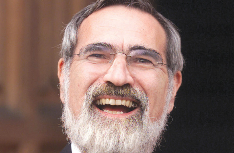 Chief Rabbi Jonathan Sacks at Lambeth Palace in 2001 after being honored as a doctor of divinity in recognition of his leadership in the Jewish community and his contribution to inter-faith relations (photo credit: REUTERS)