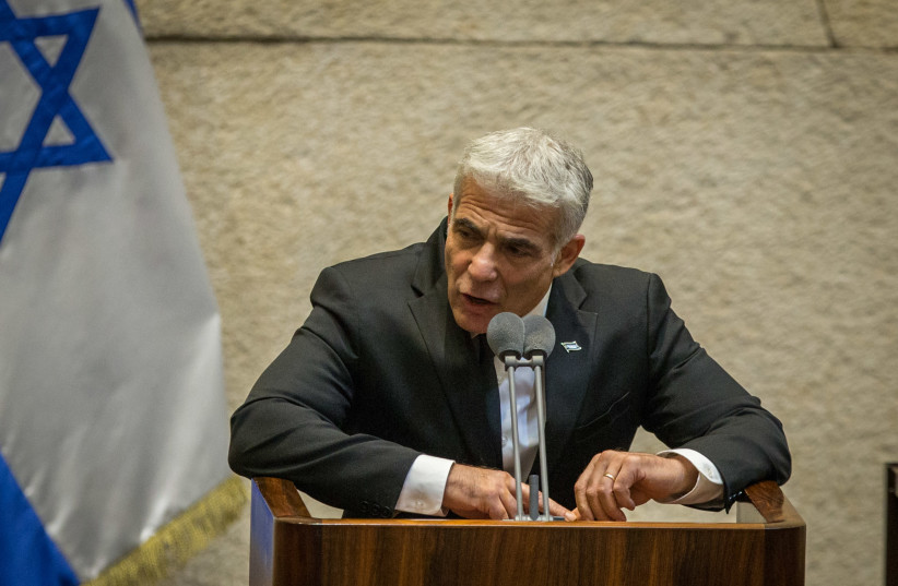 MK Yair Lapid speaks during a Knesset plenary session at the Knesset, the Israeli parliament in Jerusalem on August 24, 2020. (photo credit: OREN BEN HAKOON/POOL)
