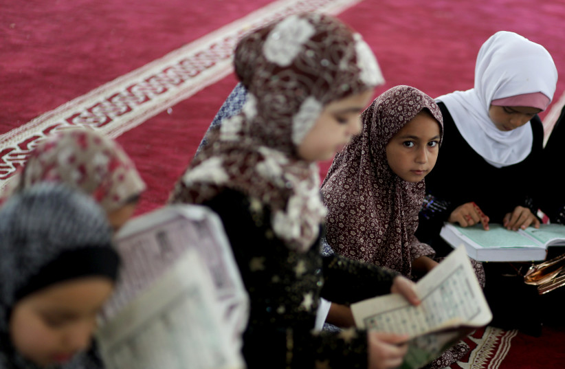 Palestinian children learn Islamic lessons on summer vacation as COVID-19 restrictions ease in Gaza. (photo credit: MOHAMMED SALEM/ REUTERS)