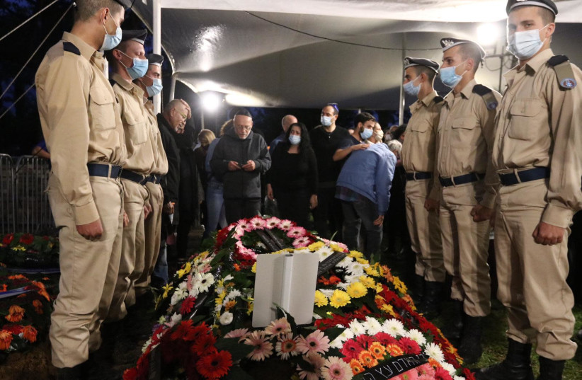 Family and friends attend the funeral of Corporal Lihu Ben-Bassa, 19, at the military cemetery in Rishon Lezion, Nov. 25, 2020. (photo credit: ALONI MOR)