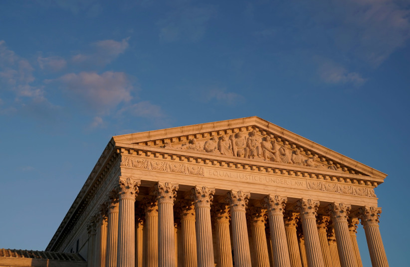 A general view of the US Supreme Court building at sunset in Washington, US, November 10, 2020. (photo credit: REUTERS/ERIN SCOTT)