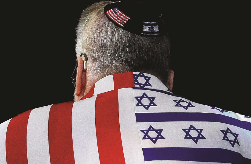 An AIPAC attendee sports a US-Israel themed suit (photo credit: TOM BRENNER/REUTERS)