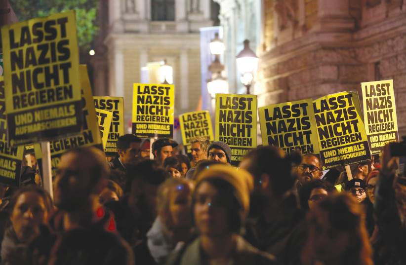 "Posters saying, ""Don't let Nazis rule"" during a protest in Vienna, 2018 (photo credit: LEONHARD FOEGER / REUTERS)"