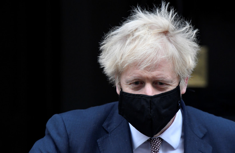 Britain's Prime Minister Boris Johnson seen in public for the first time since his self-isolation ended, leaves Downing Street during the coronavirus disease (COVID-19) outbreak in London, Britain, November 26, 2020. (photo credit: REUTERS/TOBY MELVILLE)