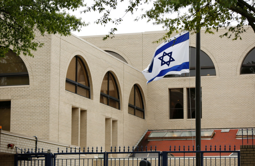 Israeli flag flies at the Israeli Embassy in Washington (credit: REUTERS/GARY CAMERON)