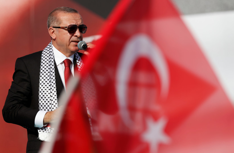 Turkish President Tayyip Erdogan delivers a speech during a protest against the recent killings of Palestinian protesters on the Gaza-Israel border and the US embassy move to Jerusalem, in Istanbul, Turkey May 18, 2018 (photo credit: REUTERS/MURAD SEZER)