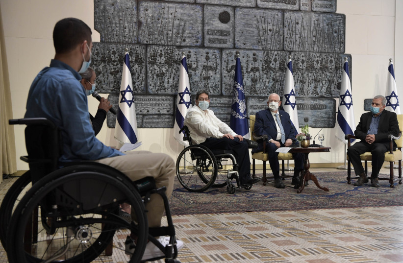 President Reuven Rivlin is seen meeting with disabled IDF veterans on December 2, 2020. (photo credit: KOBI GIDEON/GPO)