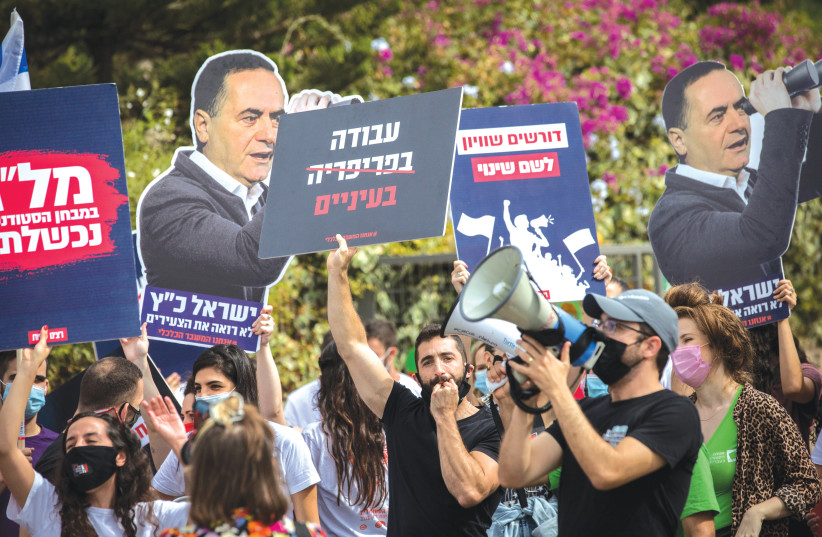 DEMONSTRATORS CALL for financial aid and equality in higher education, outside the Council for Higher Education offices in Jerusalem in October. (photo credit: YONATAN SINDEL/FLASH 90)