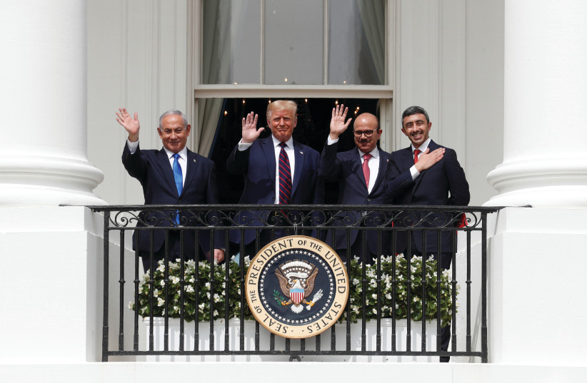 (FROM LEFT) Prime Minister Benjamin Netanyahu, US President Donald Trump, Bahrain's Foreign Minister Abdullatif al Zayani and UAE Foreign Minister Abdullah bin Zayed wave from a balcony overlooking the South Lawn of the White House in Washington, after a signing ceremony for the Abraham Accords on S (photo credit: TOM BRENNER/REUTERS)