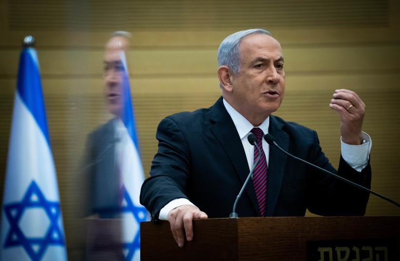 Prime Minister Benjamin Netanyahu speaking at the Knesset, December 2, 2020 (photo credit: YONATHAN SINDEL/FLASH90)