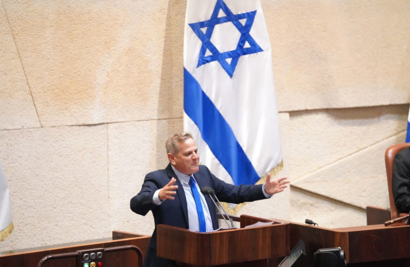 Meretz leader Nitzan Horowitz is seen gesturing at the Knesset plenum amid a vote on dissolving the Knesset, on Decemeber 2, 2020. (photo credit: KNESSET SPOKESPERSON/DANI SHEM TOV)