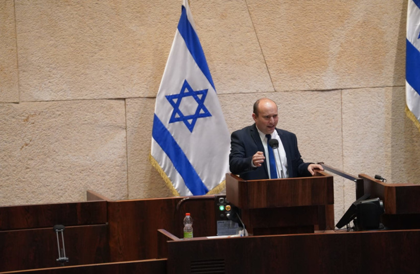 Yamina leader Naftali Bennett is seen speaking during the vote to dissolve the Knesset, on December 2, 2020. (photo credit: KNESSET SPOKESPERSON/DANI SHEM TOV)