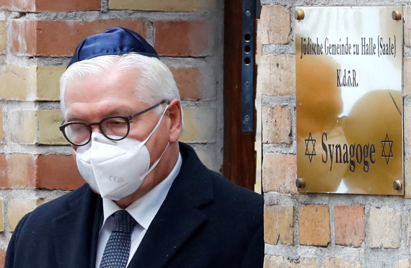 German President Frank-Walter Steinmeier leaves the synagogue at the commemoration ceremony for victims of a shooting at a synagogue and a kebab shop one year ago in Halle, Germany October 9, 2020. (photo credit: FABRIZIO BENSCH / REUTERS)