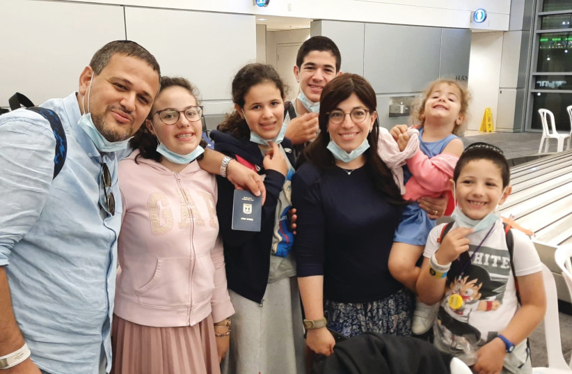 DR. CHAVA TAMIM and family are all smiles upon arrival in Israel.  (photo credit: Courtesy)