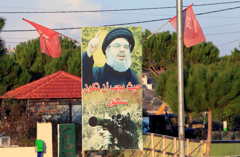 A POSTER of Hezbollah leader Hassan Nasrallah in living color in Nakoura, near the Lebanese-Israeli border, last month. (photo credit: AZIZ TAHER/REUTERS)