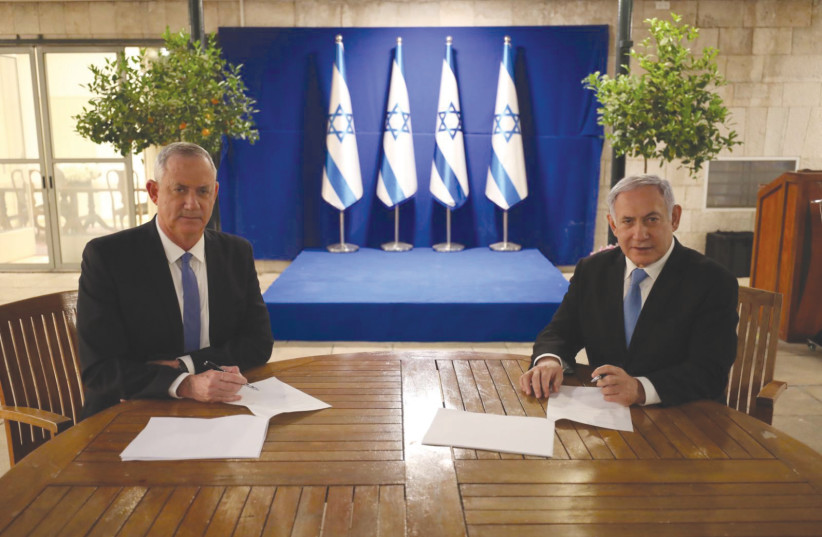 If he only knew then. Benny Gantz and Benjamin Netanyahu sign their coalition agreement on April 20 in Jerusalem. (photo credit: PRIME MINISTER'S OFFICE)