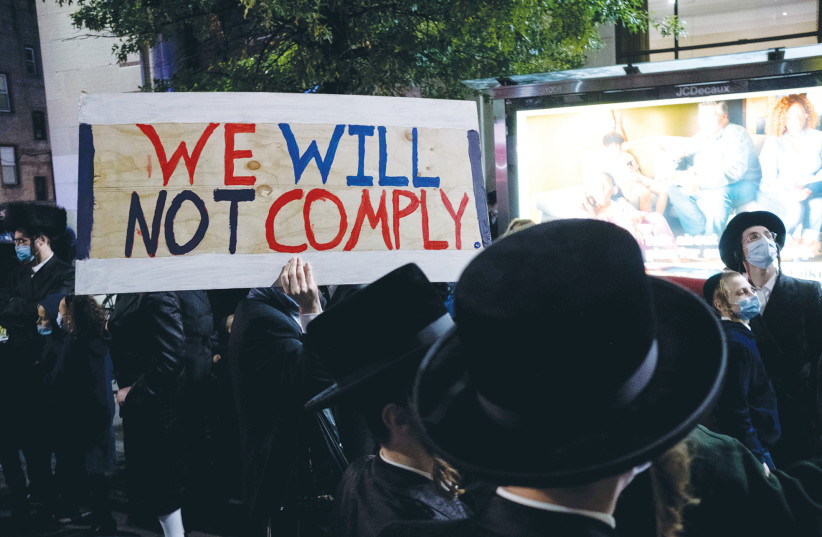 Ultra-Orthodox Jews gather in the Borough Park neighborhood of Brooklyn to protest against coronavirus restrictions, in October. (photo credit: YUKI IWAMURA/REUTERS)