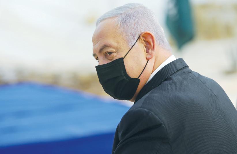 Prime Minister Benjamin Netanyahu attends the opening ceremony for the Sha'ar Hagai Memorial on the road to Jerusalem on November 29. (photo credit: ALEX KOLOMOISKY/POOL/VIA REUTERS)