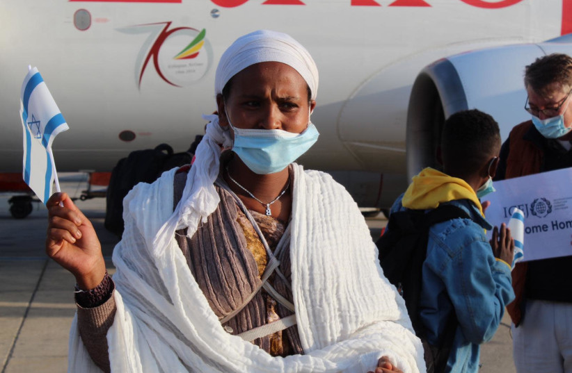 Members of the Falash Mura community from Ethiopia land in Israel as part of the second flight of the Rock of Israel operation. (photo credit: SHIRA AMAN/THE JEWISH AGENCY)