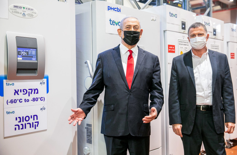 Israeli prime minister Benjamin Netanyahu and Minister of Health Yuli Edelstein visit at Teva Pharmaceuticals' logistics center in Shoham, where coronavirus vaccines would be stored and distributed, on November 26, 2020.  (photo credit: YOSSI ALONI/FLASH90)