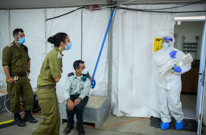 Israeli army Technicians carry out a diagnostic test for coronavirus in a IDF lab in central Israel on July 15, 2020. Photo by Yossi Zeliger/Flash90 (photo credit: YOSSI ZELIGER/FLASH90)