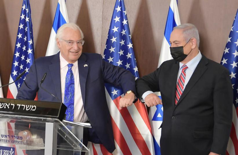 Prime Minister Benjamin Netanyahu and US Ambassador to Israel David Friedman on third anniversary of President Donald Trump's recognition of Jerusalem as Israel's capitol, December 6, 2020. (photo credit: AMOS BEN GERSHOM, GPO)
