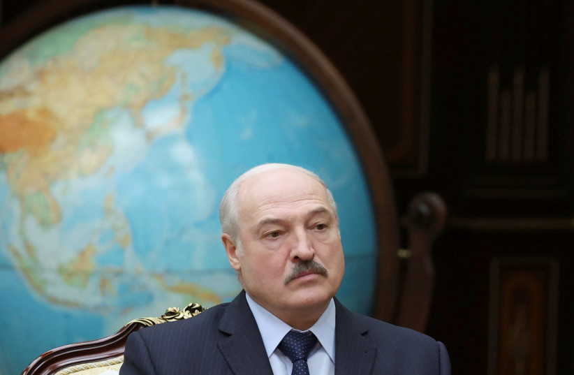 Belarusian President Alexander Lukashenko attends a meeting with Chairman of the Board of the Eurasian Economic Commission Mikhail Myasnikovich in Minsk, Belarus November 30, 2020. (credit: MAXIM GUCHEK/BELTA/HANDOUT VIA REUTERS)