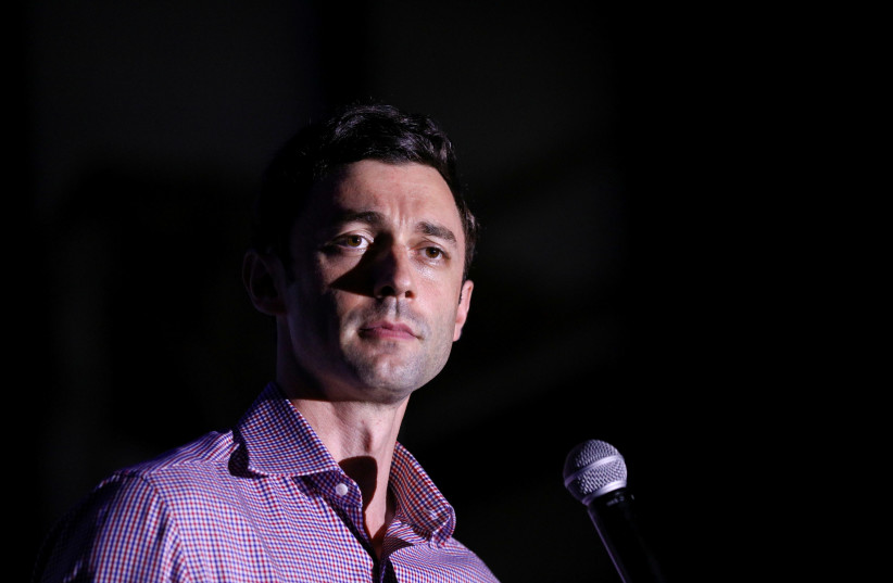 Democratic US Senate candidate Jon Ossoff attends a campaign event at the Georgia State Railroad Museum in Savannah, Georgia, US November 12, 2020.  (photo credit: REUTERS/DUSTIN CHAMBERS/FILE PHOTO)