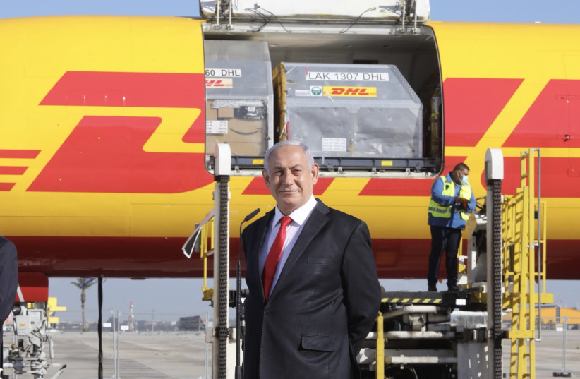 Prime Minister Benjamin Netanyahu welcomes the first shipment of Pfizer's coronavirus vaccine to Ben-Gurion Airport, Israel, December 9, 2020 (photo credit: MARC ISRAEL SELLEM/THE JERUSALEM POST)