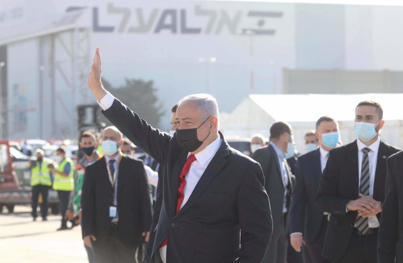 Prime Minister Benjamin Netanyahu welcomed the arrival of the first batch of Pfizer coronavirus vaccines in Israel  (photo credit: MARC ISRAEL SELLEM)