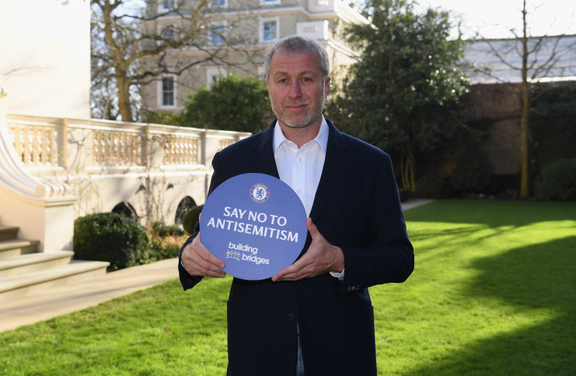 Chelsea Football Club owner Roman Abramovich holding a sign the club's ''Say No to Antisemitism'' campaign. (credit: CHELSEA FC/COURTESY)