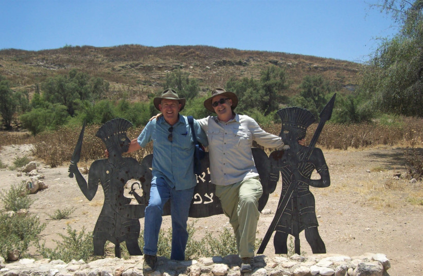 Photo of two men sitting together shows Prof. Jeff Chadwick (BYU) and Prof. Aren Maeir (BIU) at the nature park entrance to Tell es-Safi, site of the ancient biblical city of Gath (photo credit: JEFF CHADWICK)
