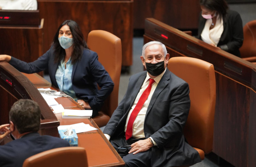 Prime Minister Benjamin Netanyahu in the Knesset plenum, December 12, 2020. (photo credit: DANI SHEM TOV/KNESSET SPOKESPERSONS OFFICE)