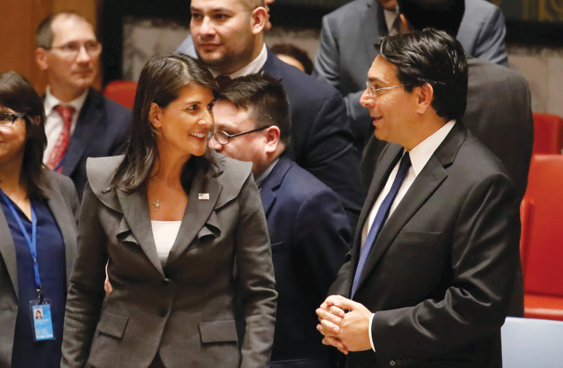 NIKKI HALEY and Danny Danon talk before a Security Council vote at UN headquarters in 2018. (photo credit: SHANNON STAPLETON / REUTERS)
