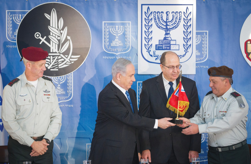 IS THE GANG getting back together again? Prime Minister Benjamin Netanyahu and then-defense minister Moshe Ya'alon present Gadi Eizenkot with the IDF pennant when he replaced Benny Gantz in 2015 as chief of staff. (photo credit: MIRIAM ALSTER/FLASH90)