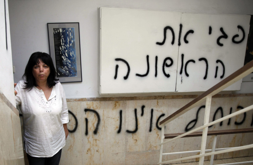 Peggy Cidor stands outside her home in Jerusalem, May 20, 2013. Cidor has made an effort in recent years to bring back Rosh Chodesh el Benat, a holiday she celebrated in Tunisia as a little girl. (photo credit: GALI TIBBON / AFP)