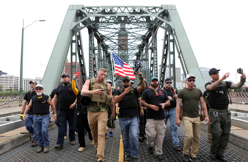 Members of the Proud Boys and their supporters march during a rally in Portland, Oregon (photo credit: REUTERS)