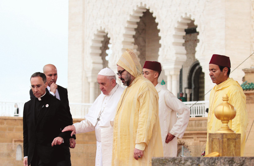 POPE FRANCIS and King Mohammed VI of Morocco visit the Hassan Tower esplanade in Rabat, Morocco, last year. (photo credit: YOUSSEF BOUDLAL / REUTERS)