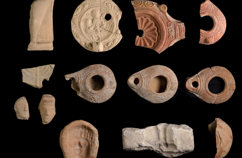 Ceramic oil lamps and stone lamp molds for their production were found along with terracotta figurines, December, 2020 (photo credit: DAFNA GAZIT/ISRAEL ANTIQUITIES AUTHORITY)