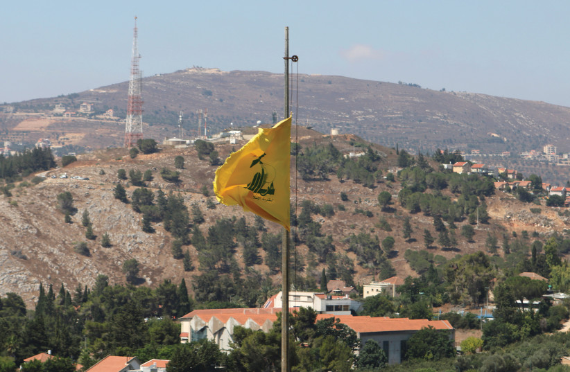 A HEZBOLLAH flag flutters in the breeze of southern Lebanon in August. (photo credit: REUTERS/KARAMALLAH DAHER)
