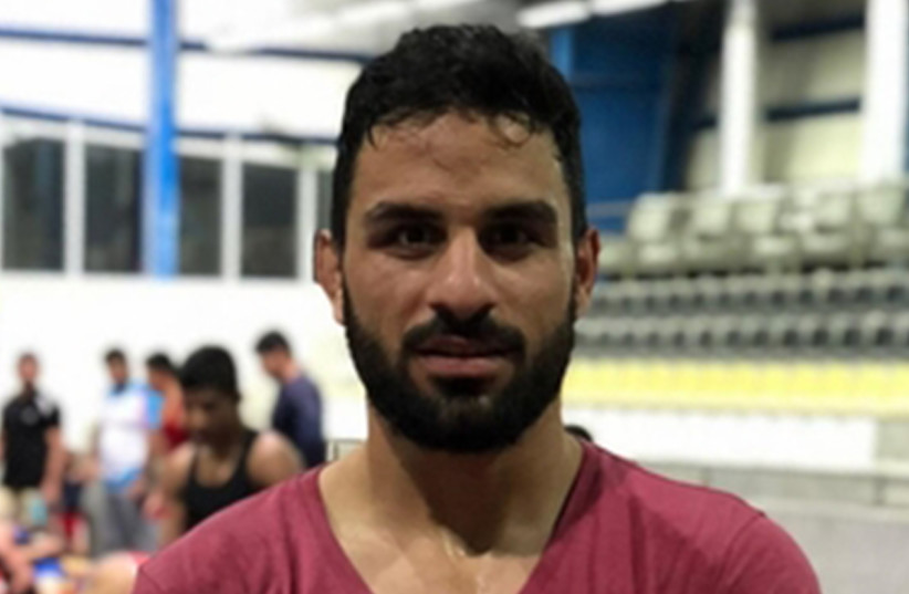 Executed Iranian wrestler Navid Afkari (photo credit: WIKIPEDIA)
