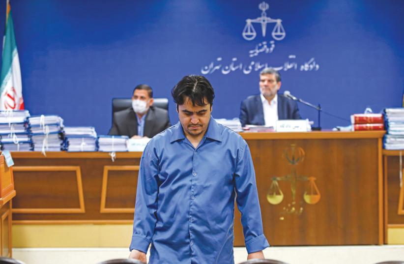 Ruhollah Zam is seen during his trial in Tehran on June 2. (photo credit: MIZAN NEWS AGENCY/WANA (WEST ASIA NEWS AGENCY) VIA REUTERS)