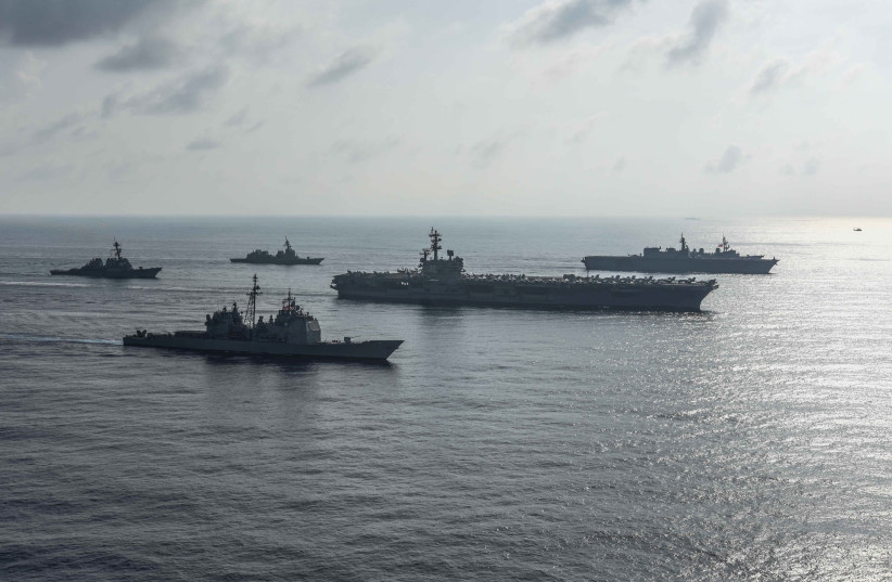 The US Navy aircraft carriers conduct a photo exercise with the Japan Maritime Self-Defense Forces in the South China Sea August 31, 2018 (photo credit: MASS COMMUNICATION SPECIALIST 2ND CLASS KAILA V. PETER/U.S. NAVY/HANDOUT VIA REUTERS)