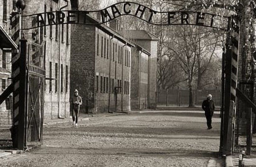 The main gate to Auschwitz with slogan 'Arbeit Macht Frei' (photo credit: PIKREPO)