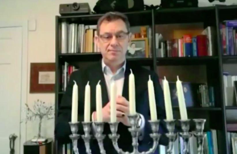 Pfizer CEO Albert Bourla lit the 7th nigh candle of Hanukkah (photo credit: SCREEN CAPTURE/ISRAEL EMBASSY IN WASHINGTON DC)