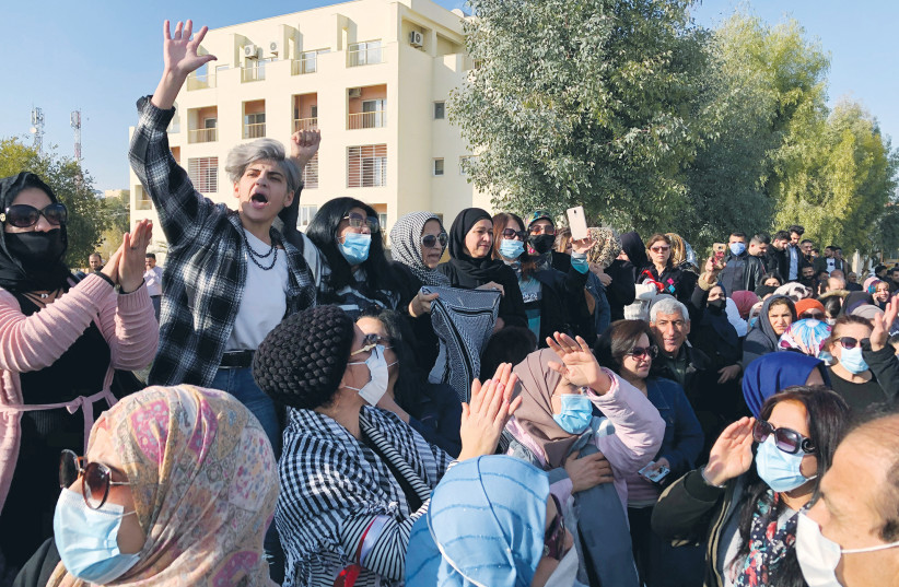 DEMONSTRATORS ATTEND an anti-Israel, anti-US rally in Karachi, Pakistan, in 2019. (photo credit: AKHTAR SOOMRO / REUTERS)