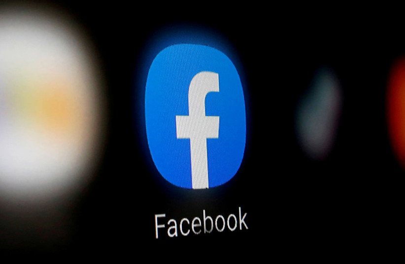 A Facebook logo is displayed on a smartphone in this illustration taken January 6, 2020 (photo credit: REUTERS/DADO RUVIC)
