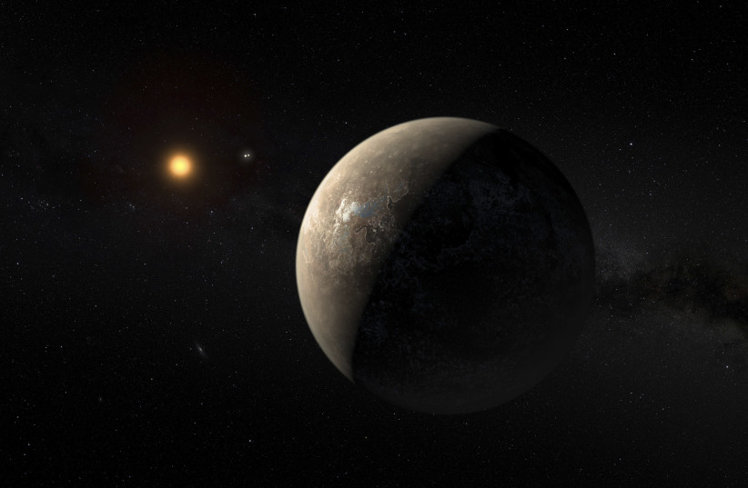 The planet Proxima b orbiting the red dwarf star Proxima Centauri, the closest star to our Solar System, is seen in an undated artist's impression released by the European Southern Observatory August 24, 2016. (photo credit: ESO/M. KORNMESSER/HANDOUT VIA REUTERS)