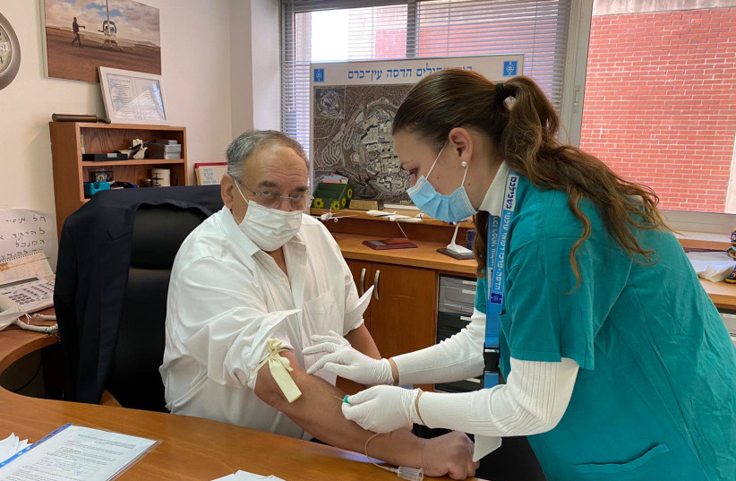 Photo of Prof. Zeev Rotstein, head of Hadassah-University Medical Center, being screened for eligibility to be vaccinated on Monday as part of the Phase II trial of the Israeli vaccine candidate Brilife. December 20, 2020 (photo credit: HADASSAH)